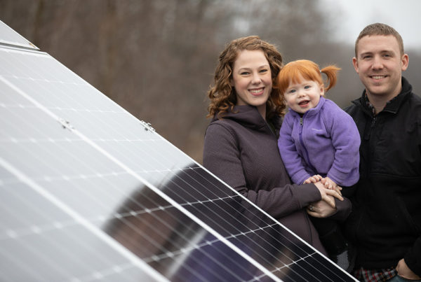 Chris and Marla Drury stand next to their home's solar panel